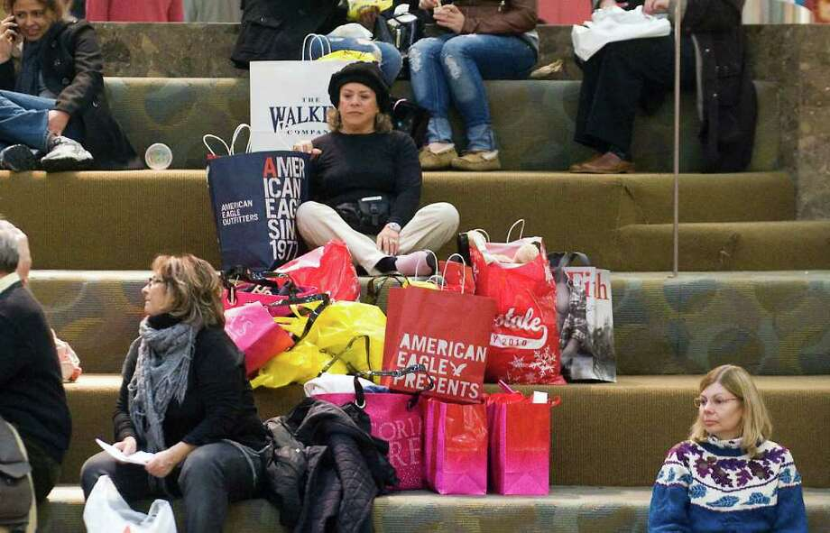 Shoppers take a break on Black Friday in the center court at the Stamford Town Center in Stamford, Conn. on Friday November 26, 2010. Photo: Staff, ST / Stamford Advocate