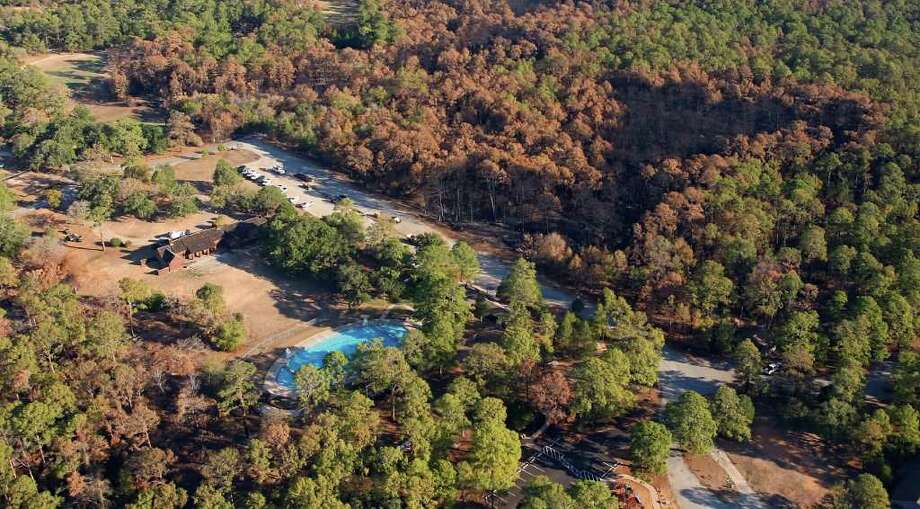 Damage from the Bastrop County Complex wildfire is seen in this Tuesday Sept. 20, 2011 aerial photo. The wild fire, which has become the most destructive in Texas' history, started September 5 and burned more than 34,000 acres.   (William Luther/wluther@express-news.net) Photo: WILLIAM LUTHER, SAN ANTONIO EXPRESS-NEWS / 2011 SAN ANTONIO EXPRESS-NEWS