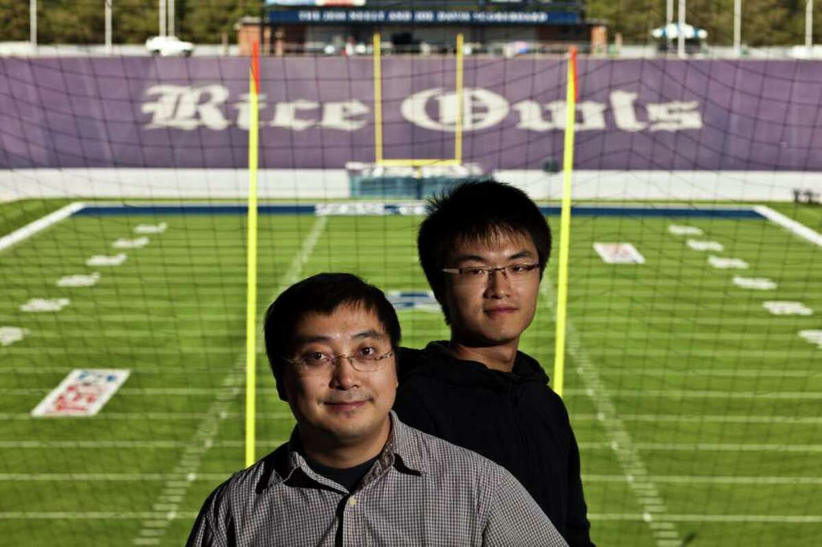 ERIC KAYNE : FOR THE CHRONICLE GOAL-ORIENTED: Dr. Lin Zhong, left, and graduate student Siqi Zhao believe their new SportSense software can use fans' tweets during NFL fans to set prices for commercials.