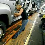 Toledo, Ohio, is close to the center, but still skews left, according to a study published this month in the American Political Science Review.FILE - In this Nov. 16, 2011 file photo, Pam Bialecki works on a 2012 Jeep Wrangler at the Chrysler Toledo Assembly complex, in Toledo, Ohio.