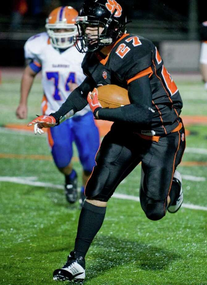 Ridgefield High School's John Turner takes off with the football against Danbury High School in a game played at Ridgefield. Wednesday, Nov. 23, 2011 Photo: Scott Mullin