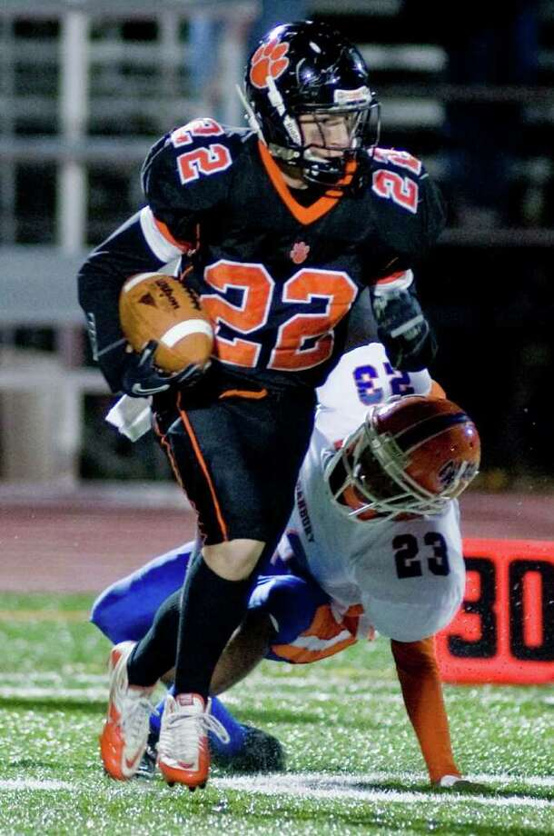 Ridgefield High School's Martin Carbone avoids a Danbury High School tackle in a football game played at Ridgefield. Wednesday, Nov. 23, 2011 Photo: Scott Mullin / The News-Times Freelance