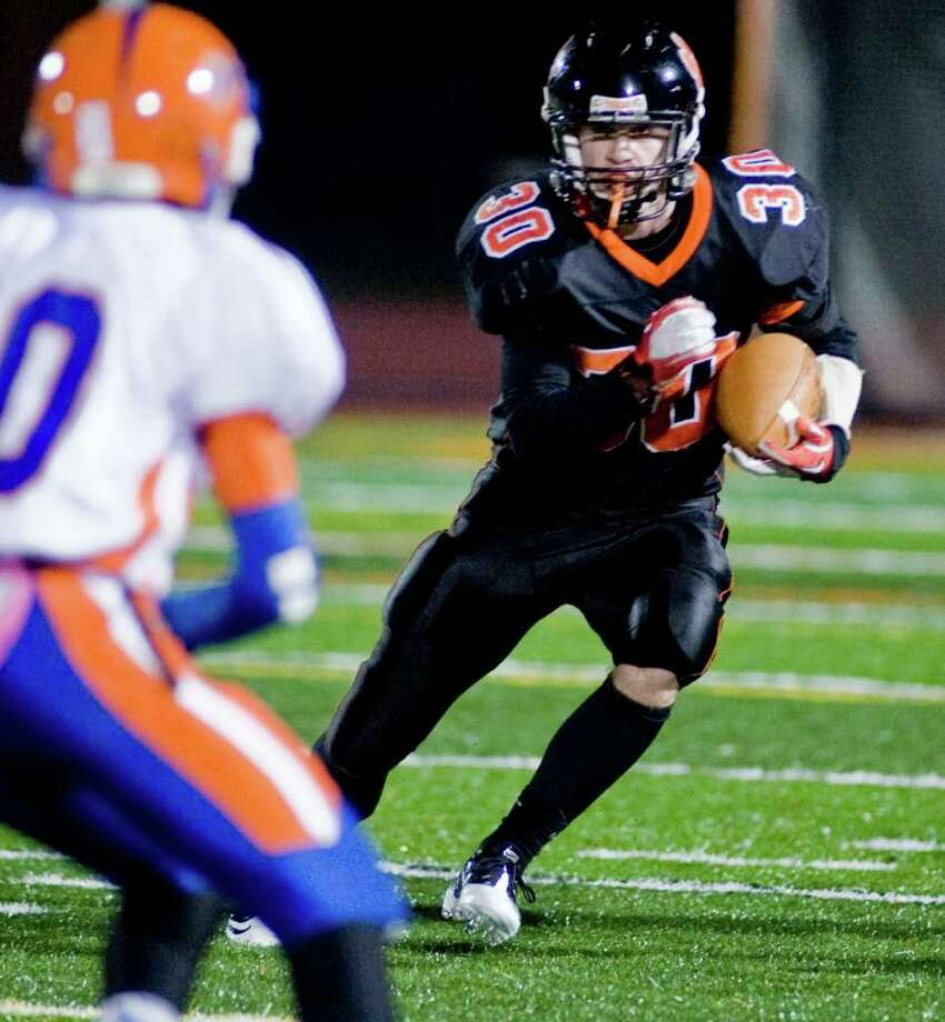 Ridgefield High School's Samuel Gravitte looks for a way through Danbury High School in a football game played at Ridgefield. Wednesday, Nov. 23, 2011 Photo: Scott Mullin / The News-Times Freelance