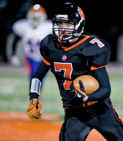 Ridgefield High School's John Heller runs with the football against Danbury High School during a game played at Ridgefield. Wednesday, Nov. 23, 2011 Photo: Scott Mullin / The News-Times Freelance