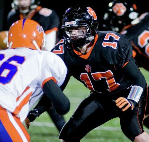 Ridgefield High School's Matthew Flanagan looks for the Danbury High School runner with the football in a game played at Ridgefield. Wednesday, Nov. 23, 2011 Photo: Scott Mullin