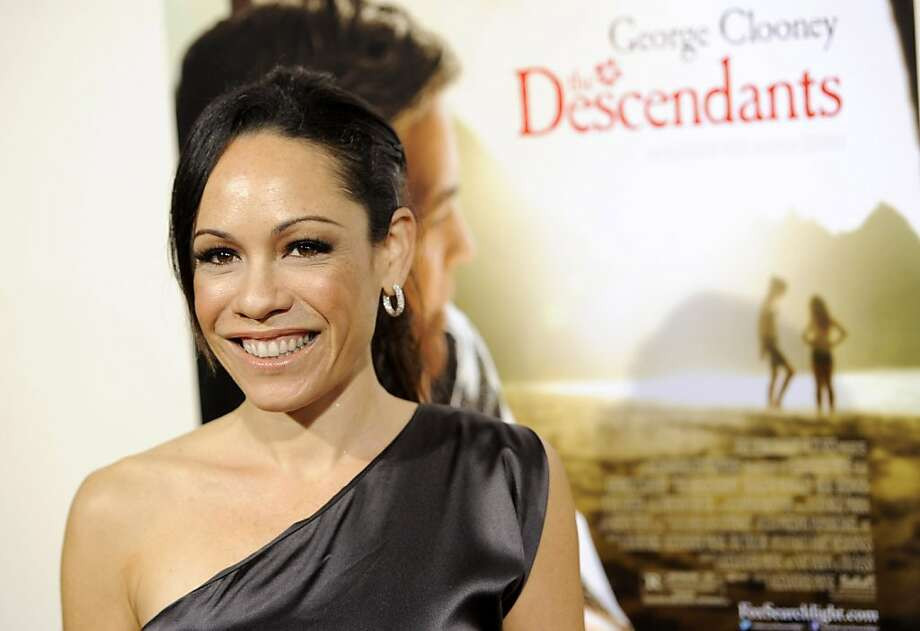 "Kaui Hart Hemmings, writer of the novel upon which the film ""The Descendants"" is based, poses at the premiere of the film, Tuesday, Nov. 15, 2011, in Beverly Hils, Calif. The film is released in New York and Los Angeles on Wednesday, and theaters nationwide on Friday. (AP Photo/Chris Pizzello) Photo: Chris Pizzello, AP"