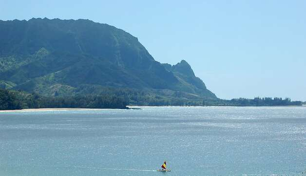 "Fringed by green mountains and golden sand, Hanalei Bay is a popular tourist destination on Kauai's North Shore -- and may be more so after ""The Descendants"" goes in widespread release. Photo: Jeanne Cooper, Special To SFGate"