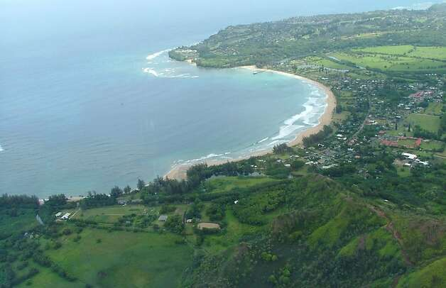 "Crescent-shaped Hanalei Bay, tiny Hanalei town and outlying farms and cottages, which form one of the spectacular settings of ""The Descendants,"" are seen from the air. Photo: Mat Münstermann"