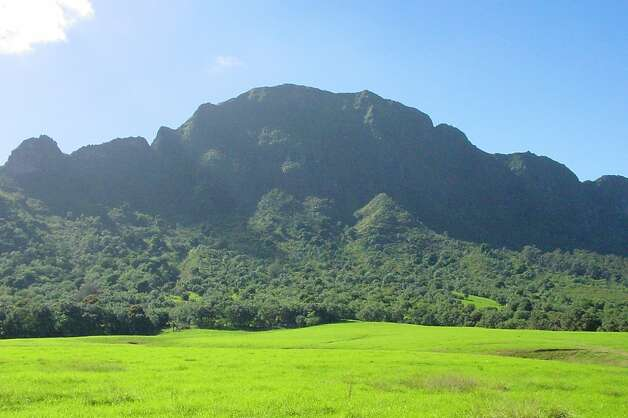 "The Ha'upu mountains separate the meadows of Kipu Ranch from oceanfront Kipu Kai, depicted in ""The Descendants"" as under threat of development. Photo: Jeanne Cooper, Special To SFGate"