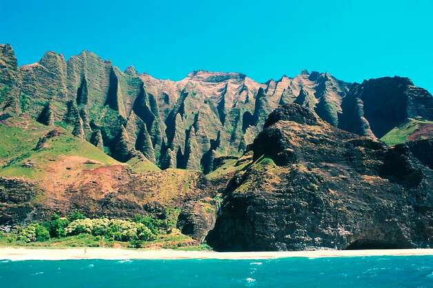 The remoteness of Kauai's Kalalau Beach, now part of the Na Pali Coast State Wilderness Park, helped preserve it from development. Photo: Kaua'i Visitors Bureau