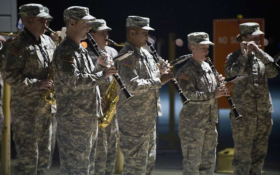 FILE -- A band plays as soldiers of the California National Guard's 640th Aviation Support Battalion arrive at the Joint Forces Training Base at Los Alamitos, Calif., on Thursday, Nov. 17, 2011. They returned after being deployed for a year in Iraq. Nearly 10,000 California National Guard soldiers have been ordered to repay enlistment bonuses a decade after signing up to serve in Iraq and Afghanistan. Photo: Mark Rightmire, AP