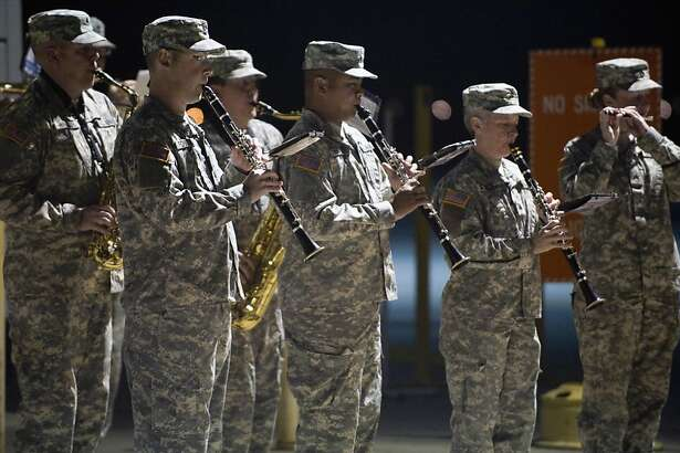 A band plays as soldiers of the California National Guard's 640th Aviation Support Battalion arrive at the Joint Forces Training Base at Los Alamitos, Calif., on Thursday, Nov. 17, 2011. They returned after being deployed for a year in Iraq. (AP Photo/Orange County Register, Mark Rightmire)   MAGS OUT; LOS ANGELES TIMES OUT
