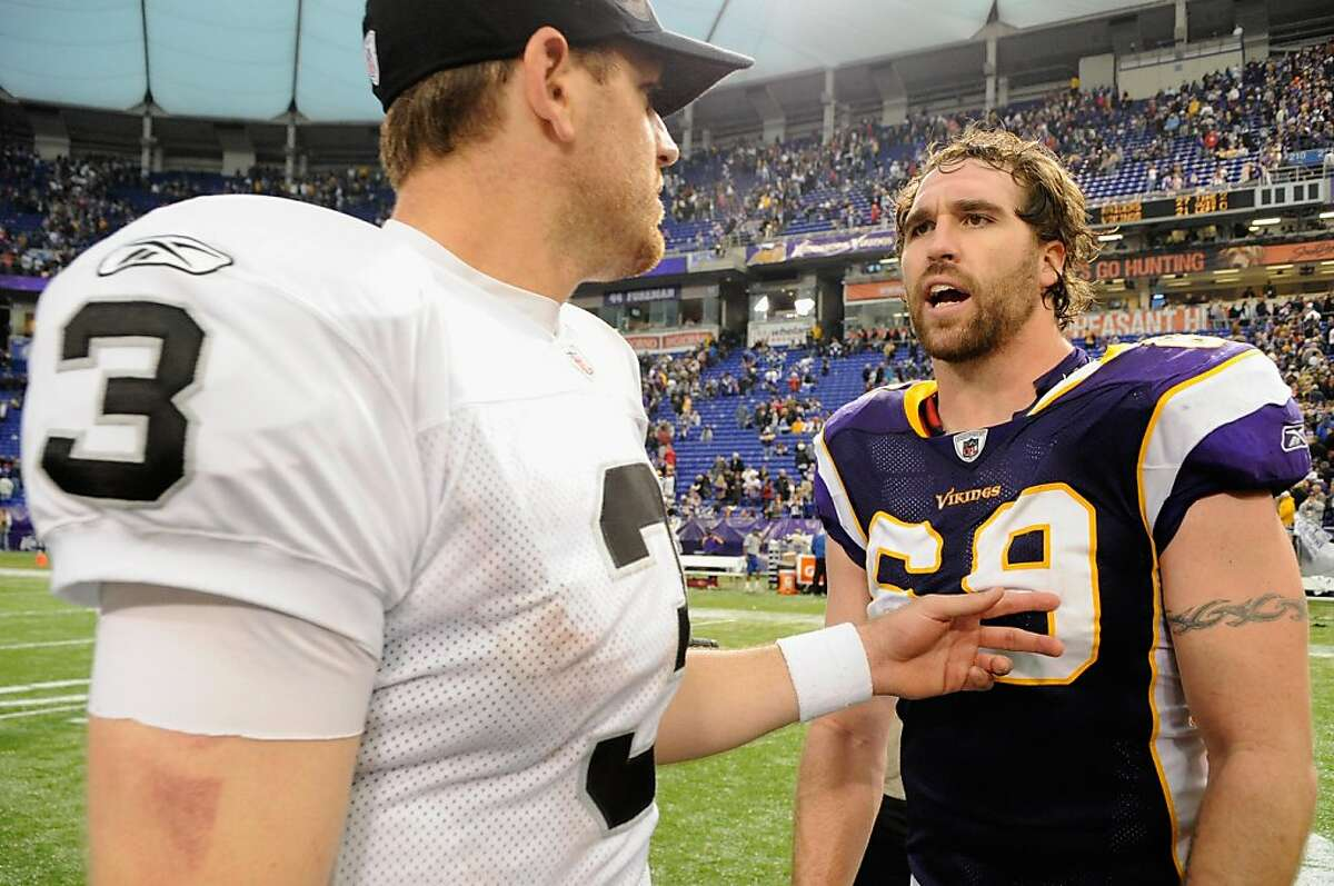 MINNEAPOLIS, MN - NOVEMBER 20: Carson Palmer #3 of the Oakland Raiders and Jared Allen #69 of the Minnesota Vikings speak following their game on November 20, 2011 at Hubert H. Humphrey Metrodome in Minneapolis, Minnesota. The Raiders defeated the Vikings 27-21. (Photo by Hannah Foslien/Getty Images)