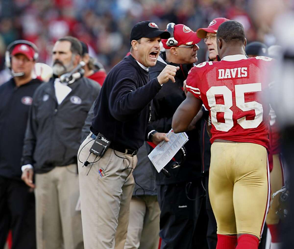 San Francisco 49ers head coach Jim Harbaugh congratulates Vernon Davis after he scores in the second half of the game against the Arizona Cardinals, Sunday November 20, 2011, at Candlestick Park in San Francisco, Calif.