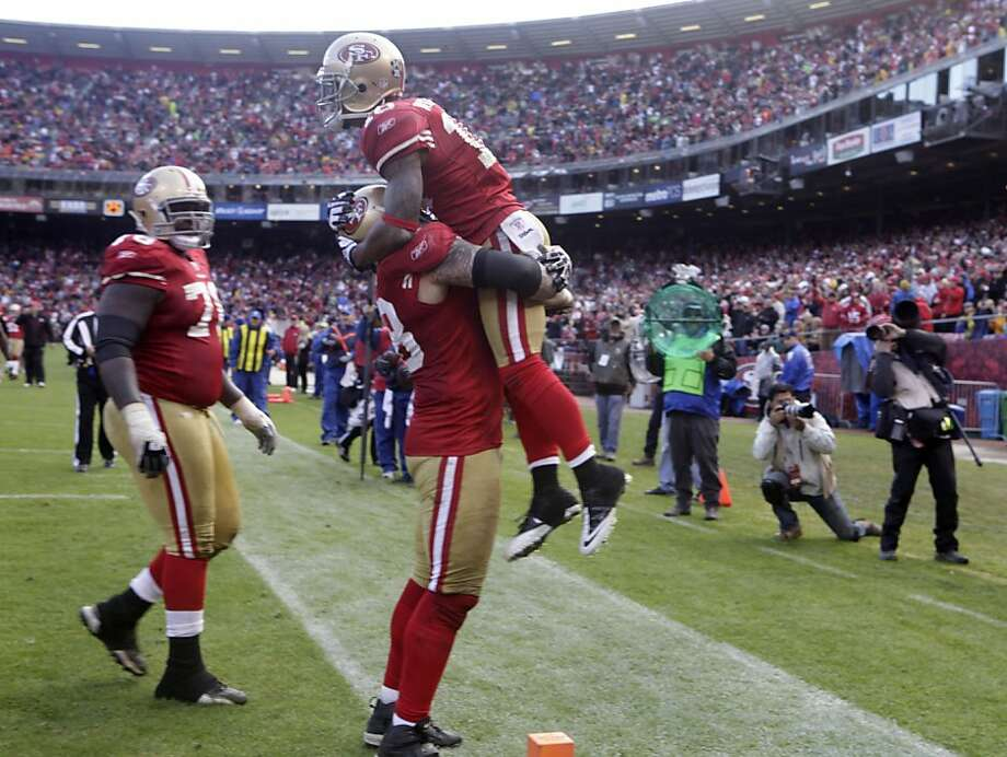 San Francisco 49ers Kyle Williams is lifted by teammates after scoring  in the second quarter against the Arizona Cardinals (3-6) Sunday November 20, 2011, at Candlestick Park in San Francisco, Calif. Photo: Lacy Atkins, The Chronicle