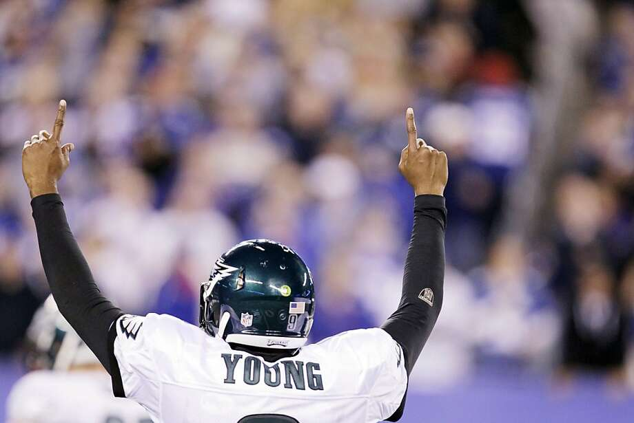 Philadelphia Eagles quarterback Vince Young reacts after throwing a touchdown pass during the second quarter of an NFL football game against the New York Giants Sunday, Nov. 20, 2011 in East Rutherford, N.J. (AP Photo/Julio Cortez)  Ran on: 11-21-2011 Philadelphia's Vince Young signals touchdown after connecting with Steve Smith for a score in the second quarter. Ran on: 11-21-2011 Philadelphia's Vince Young signals touchdown after connecting with Steve Smith for a score in the second quarter. Photo: Julio Cortez, AP