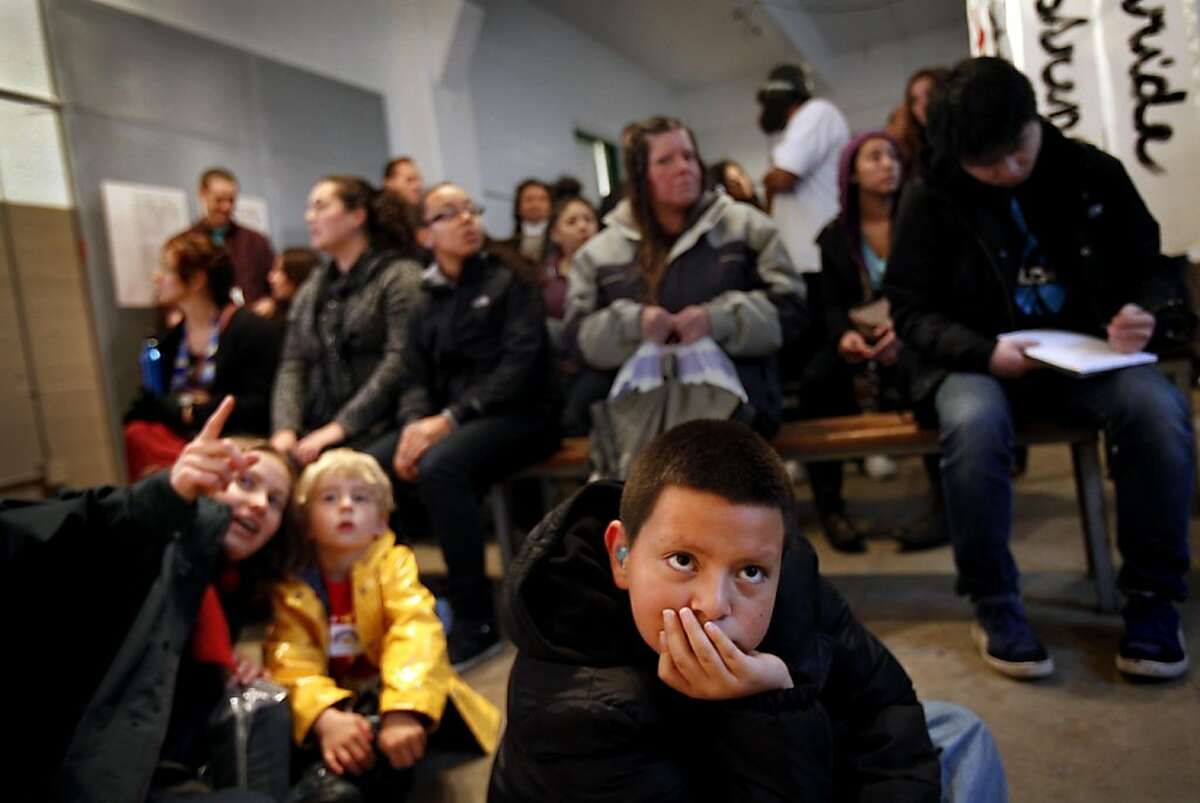 Taviano Sanchez, 10, of Union City, watches the movie at the grand opening of