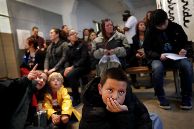 "Taviano Sanchez, 10, of Union City, watches the movie at the grand opening of ""We Are Still Here,"" a multi-media exhibit on the American Indian occupation of Alcatraz Island, on Alcatraz in San Francisco, Calif., Sunday, November 20, 2011.  Sanchez came to the opening with his mother, who came to the occupation of Alcatraz with her mother when she was a child. Photo: Sarah Rice, Special To The Chronicle"