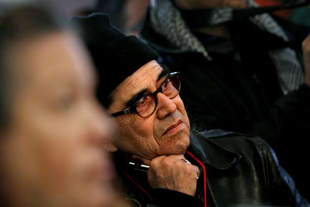 "Tony Gonzales, of San Francisco, listens at the grand opening of ""We Are Still Here,"" a multi-media exhibit on the American Indian occupation of Alcatraz Island, on Alcatraz in San Francisco, Calif., Sunday, November 20, 2011.  Gonzales is the American Indian Movement West director. Photo: Sarah Rice, Special To The Chronicle"