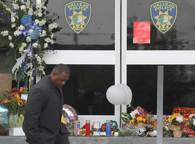 Retired Vallejo Police Cpl. Marcus Pugh visits a memorial for slain police officer James Capoot in front of the police department on Friday, Nov. 18, 2011, in Vallejo, Calif. Capoot was fatally shot by a bank robbery suspect on Thursday. Pugh had trained officer Capoot. Photo: Mathew Sumner, Special To The Chronicle