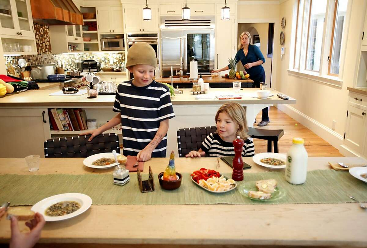Oliver Chessen, left, 10, and his sister Martha, 7, eat lunch at home in San Francisco, Calif., Sunday, November 20, 2011. Christine Chessen has been serving her three kids raw milk since 2007, and she says her whole family has been a lot healthier for it.