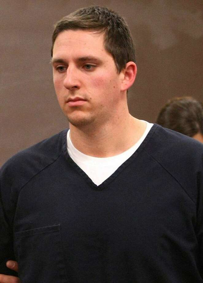 FILE - In this Jan 14, 2009 file photo, former Bay Area Rapid Transit police officer Johannes Mehserle, appears in the East Fork Justice Court in Minden, Nev.  The former San Francisco Bay area transit officer convicted in the fatal shooting of an unarmed black man that has drawn continuing protest was released from jail early Monday,June 13, 2011 after serving one year of a two-year sentence, officials said. (AP Photo/Cathleen Allison, File)  Ran on: 06-14-2011 Ex-BART police Officer Johannes Mehserle said he intended to use his Taser when he killed a rider. Photo: Cathleen Allison, Associated Press
