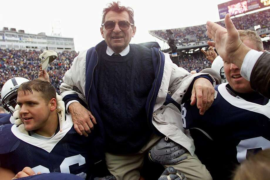STATE COLLEGE, PA - FILE: Penn State head coach Joe Paterno is celebrated for his 324th career win through defeating Ohio State after the game on October 27, 2001 at Beaver Field in State College, Pennsylvania. According to a statement on November 18, 2011, Joe Paterno has a treatable form of lung cancer. (Photo by Jamie Squire/Allsport) Photo: Jamie Squire, Getty Images