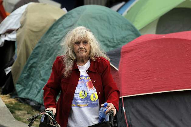A member of the Occupy Santa Rosa encampment, on Thursday November 17, 2011 in Santa Rosa, Ca., moves through the many tents set up in front of City Hall. Photo: Michael Macor, The Chronicle