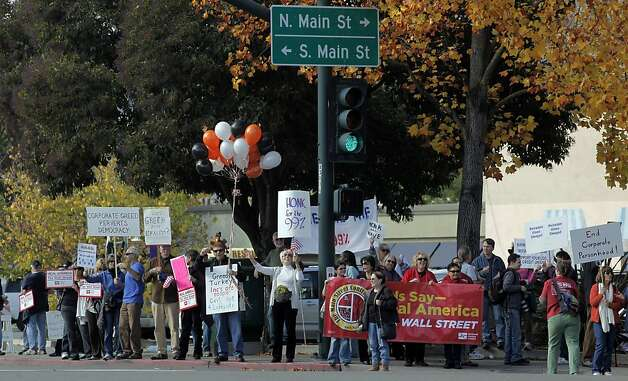"Members of Occupy Walnut Creek are joined by several other groups in support of the National Day of Action to ""Make Wall Street Pay Rally"" on the corner of Mount Diablo Boulevard and Main Street on Thursday November 17, 2011 in downtown Walnut Creek, Ca. Photo: Michael Macor, The Chronicle"