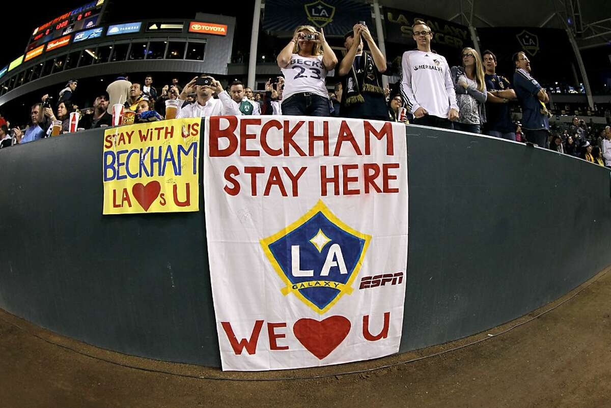 CARSON, CA - NOVEMBER 03: Fans stand behind signs hoping that David Beckham #23 of the Los Angeles Galaxy returns to the team next season bdfore the game with the New York Red Bulls in their Western Conference Semifinal at The Home Depot Center on September 9, 2011 in Carson, California. The Galaxy won 2-1 to advance to the Conference Finals. (Photo by Stephen Dunn/Getty Images)