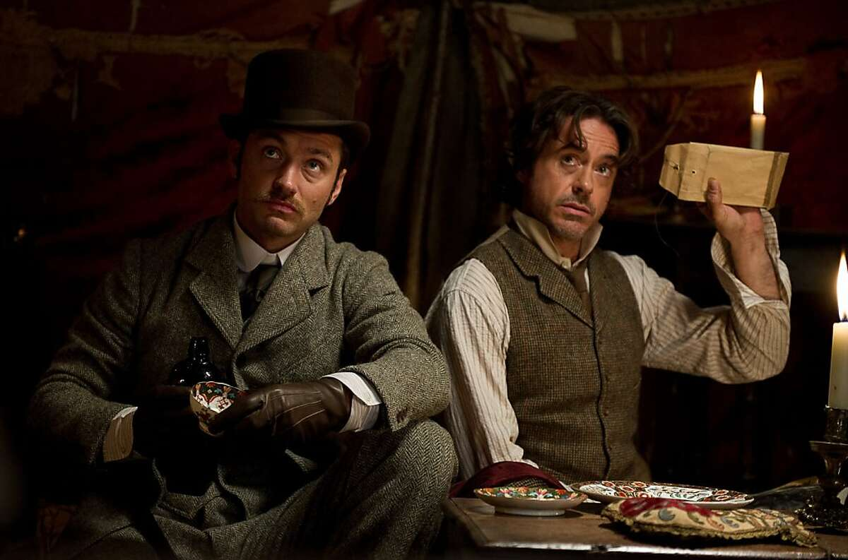 JUDE LAW as Dr. Watson and ROBERT DOWNEY JR. as Sherlock Holmes in Warner Bros. Pictures' and Village Roadshow Pictures' action adventure mystery