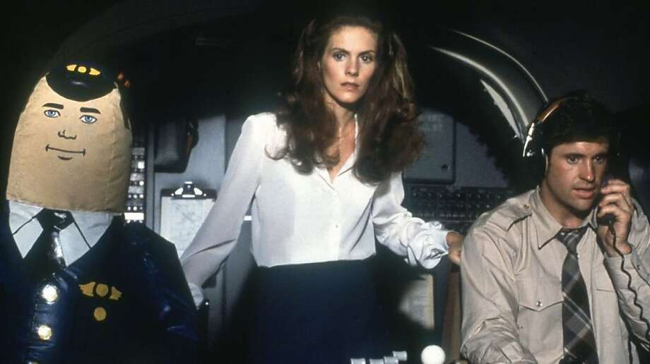 """Robert Hays in """"Airplane!""""   Ran on: 10-16-2011 Robert Hays (right) and Julie Hagerty (with a friendly autopilot on left) in &quo;Airplane!&quo; (1980). Photo: Paramount Pictures 1980"""