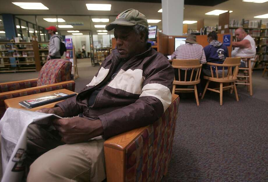 Etheridge Gordon, 63, reads a newspaper in the Vallejo Public Library on Friday, Nov. 18, 2011, in Vallejo, Calif. Photo: Mathew Sumner, Special To The Chronicle