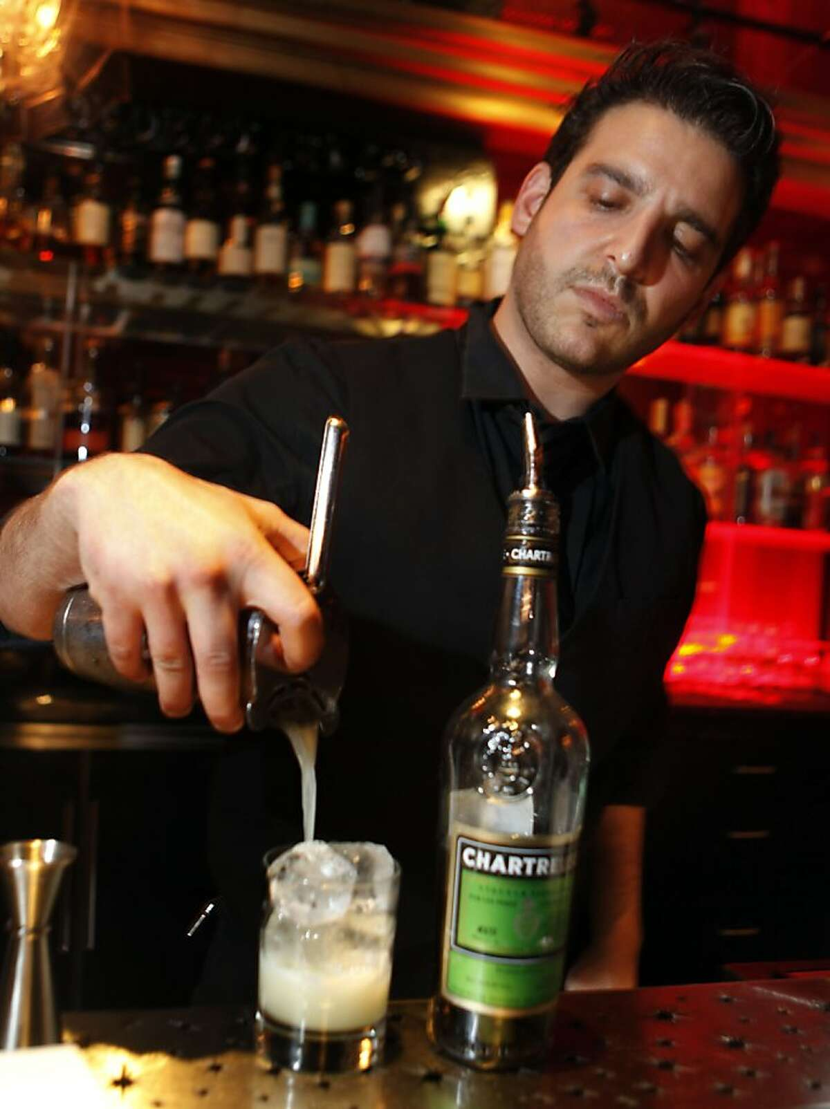 Bartender Joel Teitelbaum at Harry Denton's San Francisco Starlight Room pours his Jalapeno-infused Chartreuse. Wednesday November 16, 2011