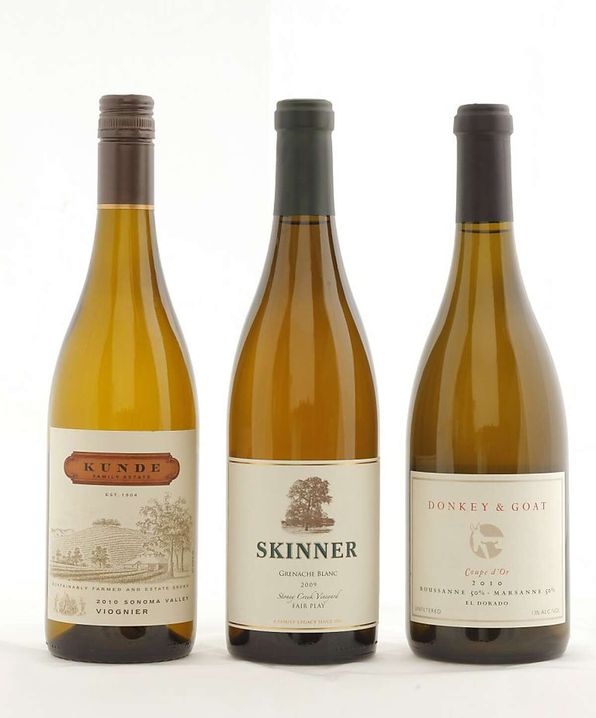 Left-right: 2010 Kunde Family Estate Sonoma Valley Viognier 2009 Skinner Stoney Creek Vineyard Fair Play Grenache Blanc 2010 Donkey & Goat Coupe d'Or El Dorado Roussanne-Marsanne as seen in San Francisco, California, on November 9, 2011. Ran on: 11-20-2011 Photo caption Dummy text goes here. Dummy text goes here. Dummy text goes here. Dummy text goes here. Dummy text goes here. Dummy text goes here. Dummy text goes here. Dummy text goes here.###Photo: GRID20_kunde_skinner_donkey1320710400SFC###Live Caption:American Rhone-Style Whites, from left: 2010 Kunde Family Estate Sonoma Valley Viognier, 2009 Skinner Stoney Creek Vineyard Fair Play Grenache Blanc, 2010 Donkey & Goat Coupe d'Or El Dorado Roussanne-Marsanne###Caption History:Left-right: __2010 Kunde Family Estate Sonoma Valley Viognier__2009 Skinner Stoney Creek Vineyard Fair Play Grenache Blanc__2010 Donkey & Goat Coupe d'Or El Dorado Roussanne-Marsanne__as seen in San Francisco, California, on November 9, 2011.###Notes:###Special Instructions:MANDATORY CREDIT FOR PHOTOG AND SF CHRONICLE-NO SALES-MAGS OUT-INTERNET__OUT-TV OUT Ran on: 11-20-2011 Photo caption Dummy text goes here. Dummy text goes here. Dummy text goes here. Dummy text goes here. Dummy text goes here. Dummy text goes here. Dummy text goes here. Dummy text goes here.###Photo: GRID20_kunde_skinner_donkey1320710400SFC###Live Caption:American Rhone-Style Whites, from left: 2010 Kunde Family Estate Sonoma Valley Viognier, 2009 Skinner Stoney Creek Vineyard Fair Play Grenache Blanc, 2010 Donkey & Goat Coupe d'Or El Dorado Roussanne-Marsanne###Caption History:Left-right: __2010 Kunde...