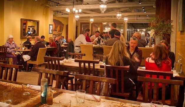 Diners enjoy dinner at Mateo's Cocina Latina in Healdsburg, Calif., on Friday, November 11,  2011. Photo: John Storey, Special To The Chronicle