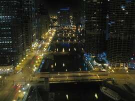 High-rise buildings line both sides of the Chicago River in Chicago, Ill., on Saturday, March 14, 2009.