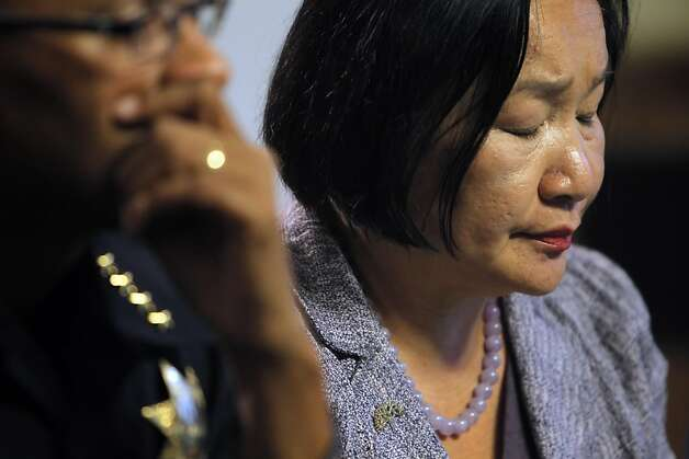 Oakland Mayor Jean Quan listens as Deanna Santana, off camera, answers a question during a press conference at City Hall in Oakland, Calif, on Wednesday, October 26, 2011. Quan, interim Police Chief Howard Jordan, and City Administrator Deanna Santana anwered questions, Wednesday, after police used tear gas and non-lethal weapons against demonstrators from the Occupy Oakland group the previous night. Photo: Carlos Avila Gonzalez, The Chronicle
