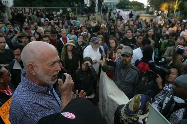 Dan Siegel, mayoral legal advisor, addresses Occupy Oakland protesters in Frank Ogawa Plaza on Wednesday, Oct. 26, 2011, in Oakland, Calif.  Ran on: 10-27-2011 Dan Siegel, an adviser to Oakland Mayor Jean Quan, addresses Occupy Oakland members. Ran on: 10-27-2011 Dan Siegel, an adviser to Oakland Mayor Jean Quan, addresses Occupy Oakland members. Ran on: 10-27-2011 Dan Siegel, an adviser to Oakland Mayor Jean Quan, addresses Occupy Oakland members. Photo: Mathew Sumner, Special To The Chronicle