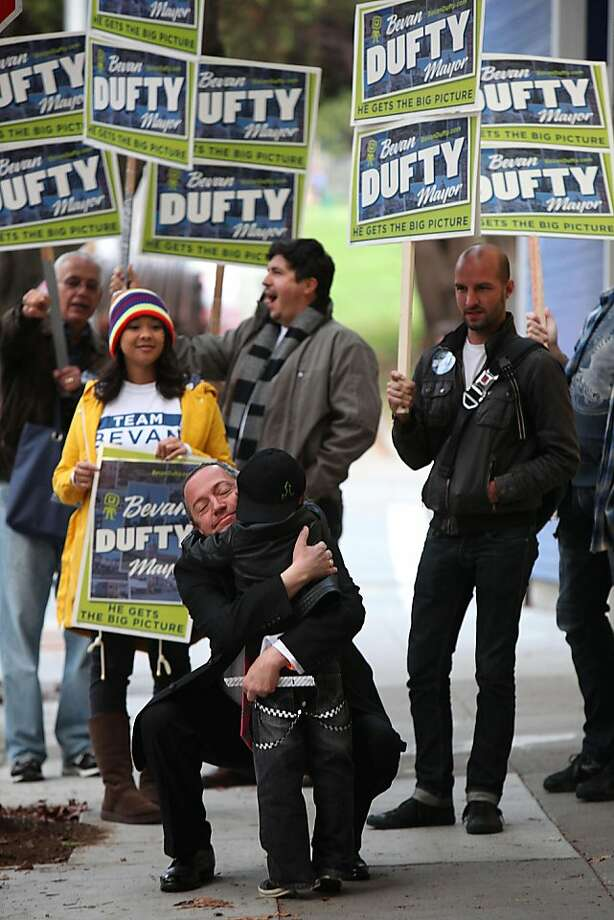 Mayoral candidate Bevan Dufty  hugs his five year old daughter Sidney Goldfader-Dufty after voting in San Francisco, Calif., on Tuesday, November 8, 2011. Photo: Liz Hafalia, The Chronicle