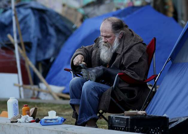 A member of Occupy SF polishes his boots outside his tent at occupy SF,  Thursday November 17, 2011, at Justin Herman Plaza in San Francisco, Calif. Photo: Lacy Atkins, The Chronicle