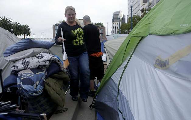 Tara Bateman and Carl Volk clean up their tent at Occupy SF,  as they gather their belongings to take to the laundry,  Thursday November 17, 2011, in San Francisco, Calif. Photo: Lacy Atkins, The Chronicle