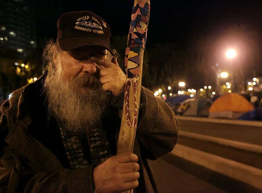 Richard Biernacki, 50 years old, takes a moment after packing up his tent and belongings in preparation of a raid  at the Occupy SF camp, Thursday November 17, 2011, at Justin Herman Plaza in San Francisco, Calif. Biernacki along  others members of the camp are putting their belongs in a safe house just in case of a raid from the police. Photo: Lacy Atkins, The Chronicle