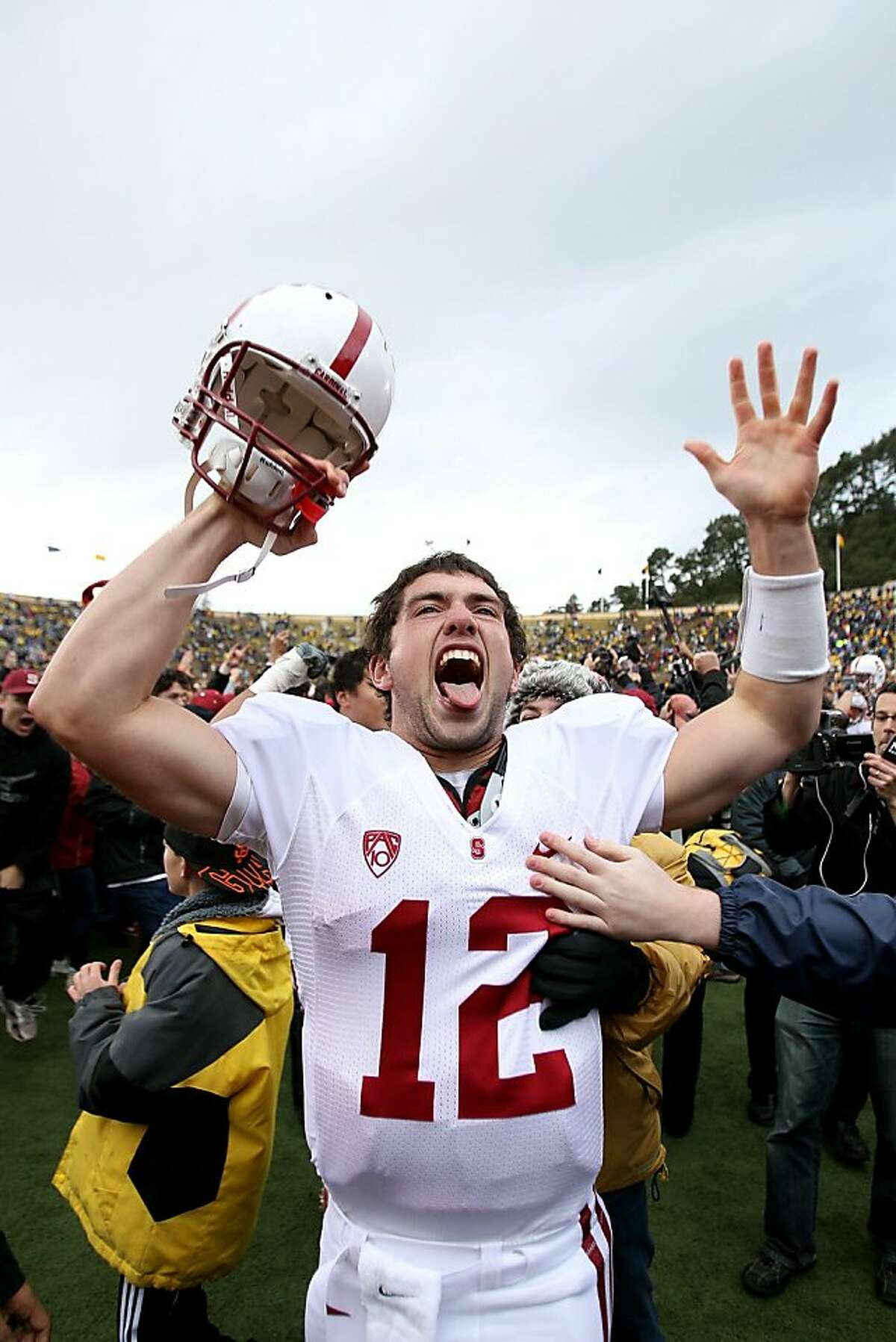 BERKELEY, CA - NOVEMBER 20: Andrew Luck #12 of the Stanford Cardinal celebrates after beating the California Golden Bears at California Memorial Stadium on November 20, 2010 in Berkeley, California. (Photo by Ezra Shaw/Getty Images) Ran on: 11-22-2010 Andrew Luck, exulting after Saturdays win, is a strong Heisman candidate. Ran on: 11-22-2010 Andrew Luck, exulting after Saturdays win, is a strong Heisman candidate.