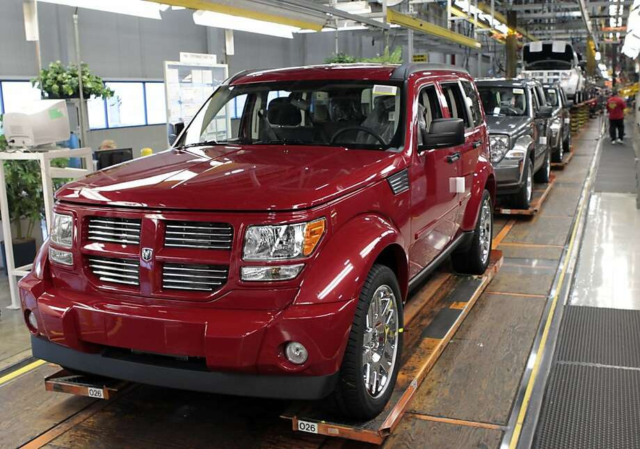 A Chrysler Group LLC Dodge Nitro sits on the production line at Chrysler's Toledo Assembly Complex in Toledo, Ohio, U.S., on Wednesday, Nov. 16, 2011. Chrysler Group LLC said it will invest $1.7 billion to update a Jeep sport-utility vehicle and add a second shift at its factory in Toledo in the third quarter of 2013. Photographer: Jeff Kowalsky/Bloomberg Photo: Jeff Kowalsky, Bloomberg