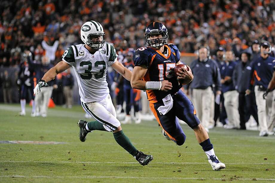 DENVER, CO - NOVEMBER 17: Tim Tebow #15 of the Denver Broncos runs for the game winning touchdown against Eric Smith #33 of the New York Jets at Sports Authority Field at Mile High on November 17, 2011 in Denver, Colorado.  (Photo by Garrett W. Ellwood/Getty Images) Photo: Garrett Ellwood, Getty Images