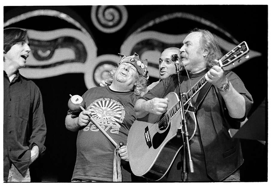 "Wavy Gravy (middle) jams with Jackson Browne (left) and David Crosby (right) in an archival scene from Michelle Esrick's 2010 documentary about Berkeley's Wavy Gravy, ""Saint Misbehavin.' ""    Ran on: 12-02-2010 Wavy Gravy (middle) jams with Jackson Browne (left) and David Crosby (right) in a scene from Michelle Esrick's &quo;Saint Misbehavin.&quo; Ran on: 12-03-2010 Wavy Gravy (middle) jams with Jackson Browne (left) and David Crosby in an archival scene from Michelle Esrick's documentary. Photo: Ripple Effect Film Production"
