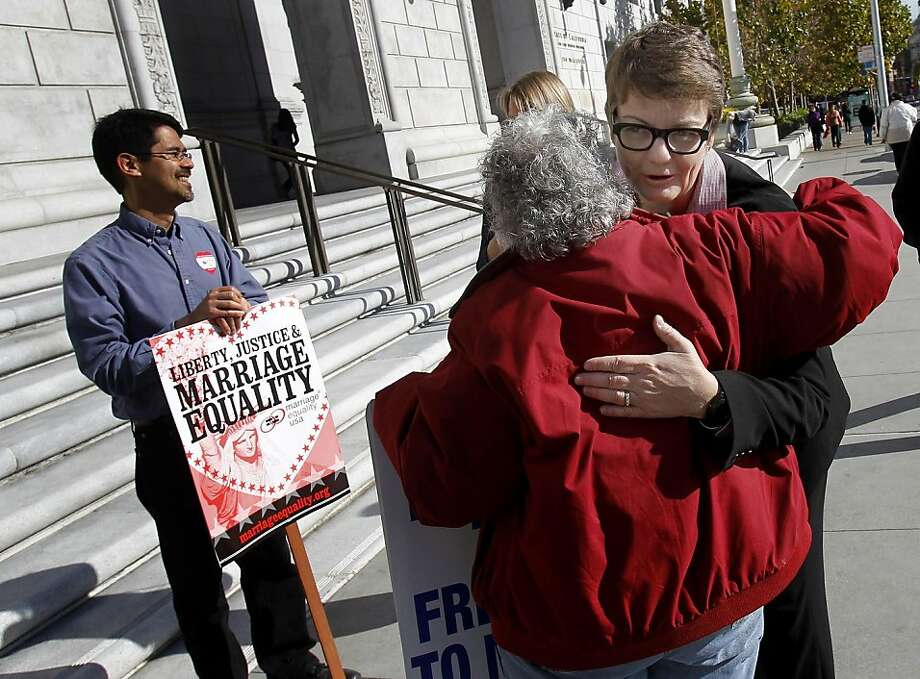 Plaintiff Kris Perry hugged a marriage equality supporter on the steps of the state Supreme court building. The California Supreme Court cleared the way Thursday November 17, 2011 for a federal court test of the state's ban on same-sex marriage, ruling that sponsors of the voter-approved measure have the right to appeal a federal judge's ruling that struck it down. Photo: Brant Ward, The Chronicle