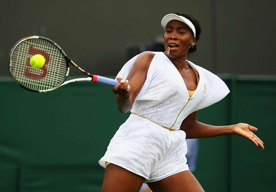 LONDON, ENGLAND - JUNE 20:  Venus Williams of the United States returns a shot during her first round match Akgul Amanmuradova of Uzbekistan on Day One of the Wimbledon Lawn Tennis Championships at the All England Lawn Tennis and Croquet Club on June 20, 2011 in London, England.  (Photo by Julian Finney/Getty Images)  *** BESTPIX ***  Ran on: 06-21-2011 Venus Williams' outfit  --  which she called &quo;a jumper&quo;  --  didn't prevent her from returning with authority during her first-round match, which she won easily over Akgul Amanmuradova. Photo: Julian Finney, Getty Images