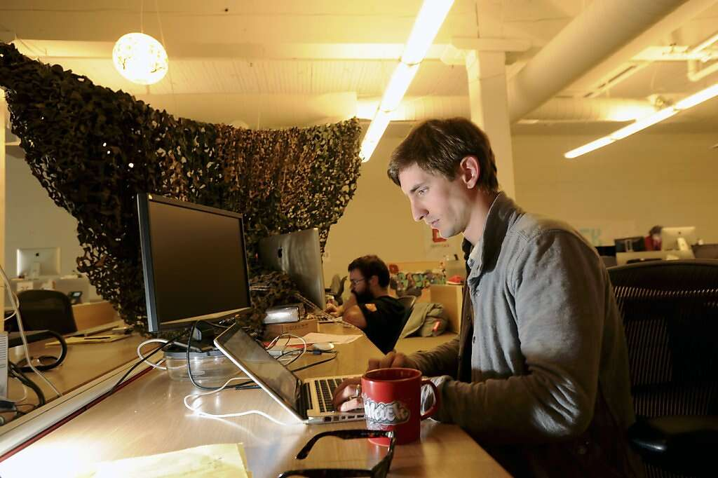san francisco rackspace office. With Camouflage Netting Draped Over The End Of His Desk Row, Dan Di Spaltro, San Francisco Rackspace Office P